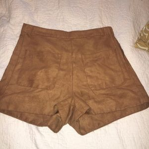 Suede high waisted shorts. Gold zipper on side.